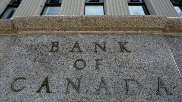 Bank of Canada stays on hold, cuts growth forecast