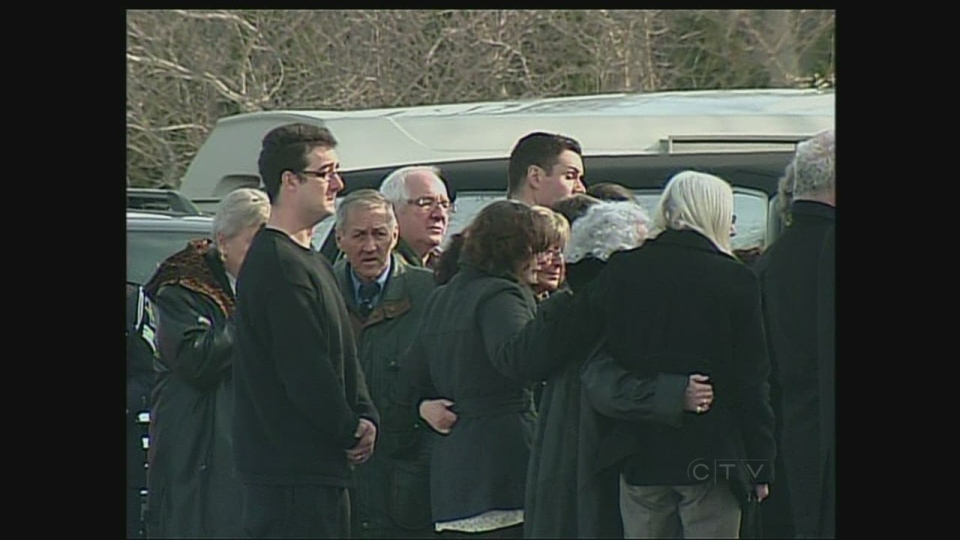 Mourners attend the funeral for 27-year-old Noelle Paquette in Brights Grove, Ont. on Tuesday, Jan. 8, 2013.