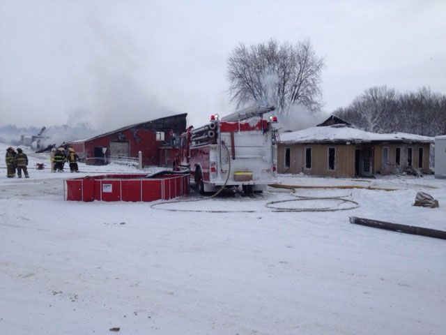 Firefighters battle a structure fire at MDL Doors south of Brussels, Ont. on Wednesday, Jan. 23, 2013. (Scott Miller / CTV London)