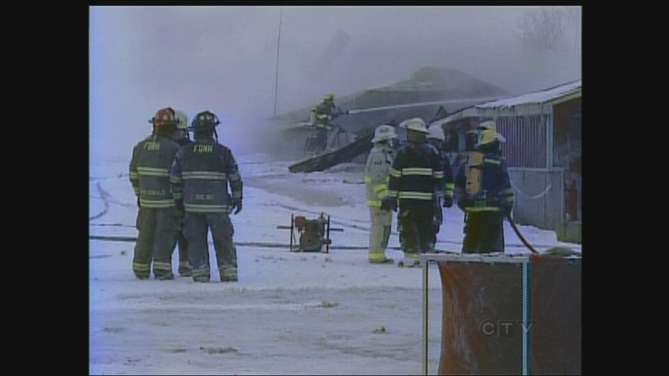 Firefighters battle a blaze at MDL Doors in Huron County, Ont. on Wednesday, Jan. 23, 2013.