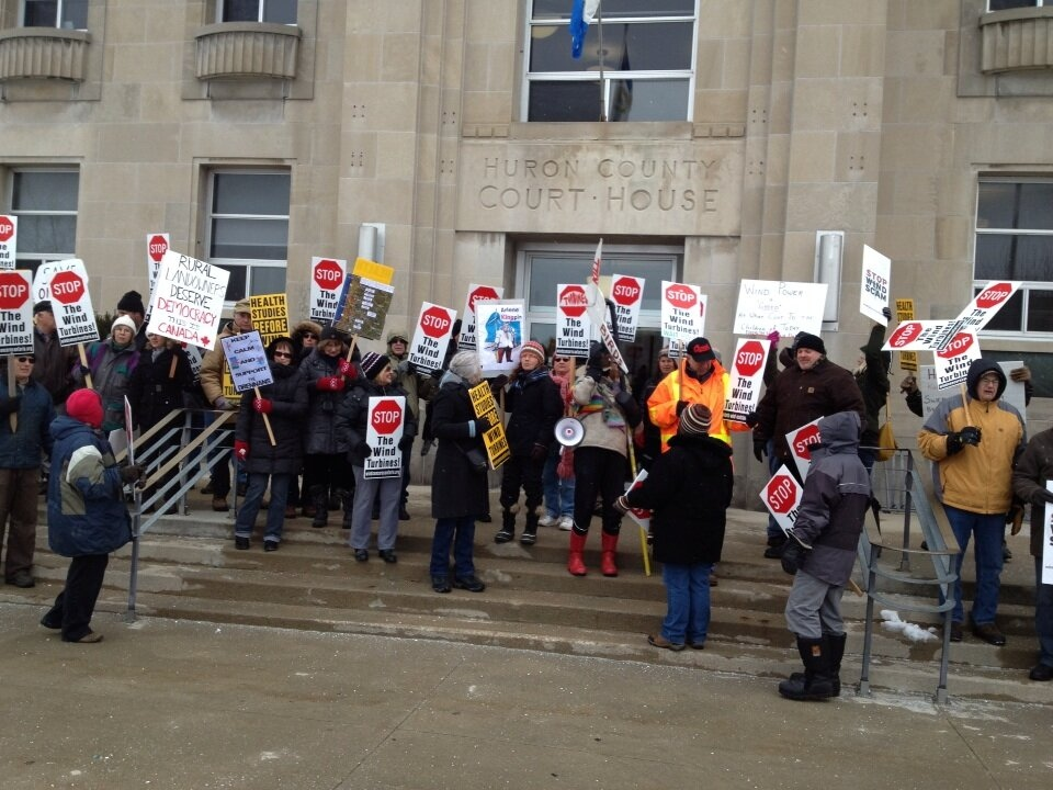 Protestors rally outside the Goderich courthouse as the K2 Wind farm goes on trial, on Friday, March 1, 2013. (Scott Miller / CTV London)