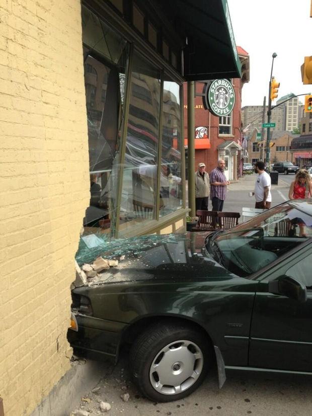 A car crashed into a Starbucks at Central and Richmond in London, Ont., on Tuesday, May 21, 2013. (Bryan Bicknell / CTV Windsor)