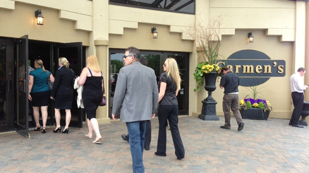 Mourners arrive for the memorial of Tim Bosma at Carmen's Banquet Hall in Hamilton, Ont., Wednesday, May 22, 2013. (Byron Auburn / CTV Toronto Photojournalist)