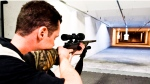 Range officer Patrick Deegan aims a long gun at a private range in Calgary on Sept. 15, 2010 photo. The Supreme Court is set to rule on whether Quebec can maintain data on gun owners that was part of the now defunct federal gun registry. (Jeff McIntosh / THE CANADIAN PRESS)
