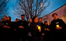 Members of SPLASH, the Etobicoke School of the Arts' show choir sing before a WWF-Canada lantern walk in Roncesvalles Village Toronto, celebrating Earth Hour, Saturday, March 23, 2013. THE CANADIAN PRESS/Galit Rodan