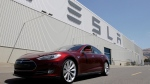 This file photo shows a Tesla Model S driving outside the Tesla factory in Fremont, Calif., June 22, 2012 file. (AP / Paul Sakuma, File)