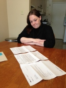 Jessica Clark looks at her tax forms, and those of a complete stranger, sent to her by the Canada Revenue Agency, in Hanover, Ont. on Tuesday, March 3, 2015. (Scott Miller / CTV London)