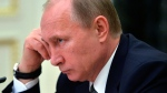 Russian President Vladimir Putin attends a cabinet meeting in Moscow, Wednesday, March 4, 2015. (RIA Novosti / Alexei Druzhinin, Presidential Press Service)