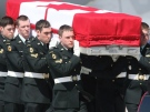The casket of Pte. Tyler William Todd from the 1st Battalion, Princess Patricia's Canadian Light Infantry, based in Edmonton, Alberta, is carried from a military aircraft during a repatriation ceremony at CFB Trenton on Wednesday, April 14 2010. (THE CANADIAN PRESS/Peter Redman)