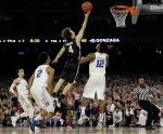 Gonzaga's Kevin Pangos shoots against Duke forward Justise Winslow (12) during the second half of a college basketball regional final game in the NCAA Tournament on March 29, 2015, in Houston. (David J. Phillip / AP Photo)