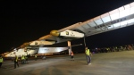 Ground crew members move a solar powered plane into a hangar after it landed at Chongqing Jiangbei International Airport in southwest China's Chongqing Municipality on March 31, 2015. (AP)