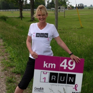 CTV's Jan Sims gets warmed up for her part of the OneRun as she waits for Theresa Carriere to arrive near Watford, Ont. on Friday, June 12, 2015. (Norman James / CTV London)