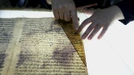 A member of the library restoration staff works on a damaged document at the Baghdad National Library in Iraq on July 28, 2015. (AP / Karim Kadim)