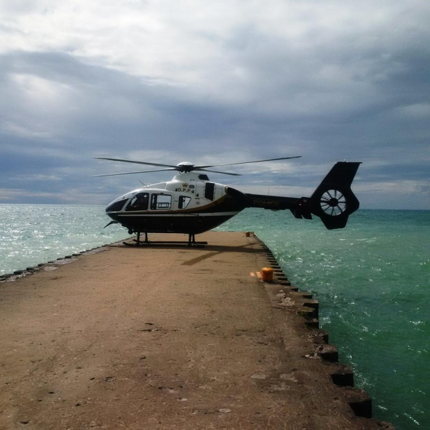 An OPP helicopter takes part in a search for a missing 16-year-old swimmer near Kincardine, Ont. on Tuesday, Aug. 4, 2015. (@OPP_WR / Twitter)