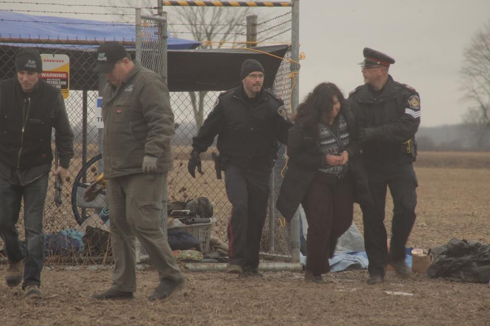 Protesters are arrested after temporarily shutting down Enbridge's Line 9 at a site in Sarnia, Ont. on Monday, Dec. 21, 2015. (The Indignants / Facebook)