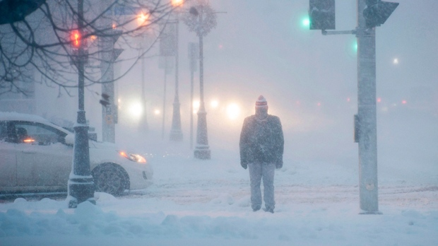 A pedestrian trudges through the snow in Fredericton on December 15, 2015.  THE CANADIAN PRESS/Stephen MacGillivray