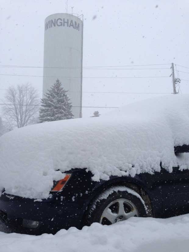 A vehicle is covered in snow in Wingham, Ont. on Monday, Jan. 18, 2016. (Scott Miller / CTV London)