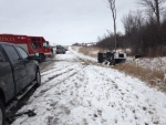 A Voyageur van, with passengers on board, flipped onto its side on Highbury Avenue in London, Ont. on Wednesday, Jan. 27, 2016. (Gerry Dewan / CTV London)