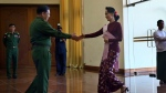 Senior General Min Aung Hlaing, left Commander in Chief of Myanmar Defense Services reaches to shake hands with pro-democracy icon Aung San Suu Kyi during their meeting in Naypyitaw, Burma on Wednesday, Dec. 2, 2015. (AP / Aung Shine Oo)