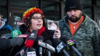 Jennifer Neville-Lake holds a photo of her son Daniel as husband Ed looks on as she gives a statement outside the Newmarket courthouse following the release of Marco Muzzo on bail on Thursday, Feb. 4, 2016. (Christopher Katsarov / THE CANADIAN PRESS)