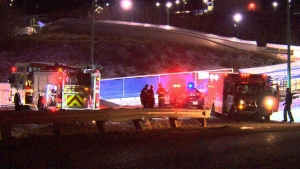 Emergency officials attend the scene after two young men are dead and six others are injured following an after-hours incident at a Calgary luge-bobsled track on Saturday, Feb. 6, 2016.
