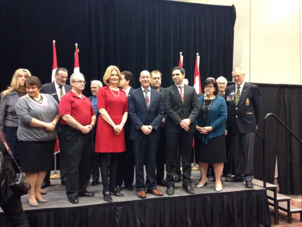Officials gather on stage at an announcement of federal funding for infrastructure projects in London, Ont. on Monday, Feb. 8, 2016. (Nick Paparella / CTV London)
