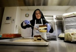 Sister Mary Valerie places cake on a tray to serve at the Fraternite Notre Dame Mary of Nazareth Soup Kitchen in San Francisco, Tuesday, Feb. 9, 2016. (AP / Jeff Chiu)