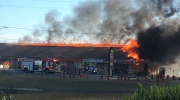 A fire engulfs a plaza at 1700 Hyde Park Rd. in London, Ont. on Thursday, June 30, 2016.