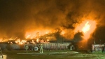 Fast-moving fire engulfs barn in Courtenay