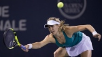 Eugenie Bouchard returns to Kristina Kucova during third round of play at the Rogers Cup tennis tournament in Montreal on Thursday July 28, 2016. (Paul Chiasson / THE CANADIAN PRESS)