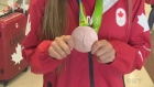 Shelina Zadorsky shows off her bronze medal