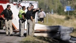 """Missoula County sheriff's deputies look at the wreckage of a Cessna 182 that crashed on the shoulder of Interstate 90 near Rock Creekont., on Sunday, Aug. 28, 2016. The crash killed 52-year-old Darrell Ward of Deer Lodge, a star of the History channel series """"Ice Road Truckers"""" and pilot Mark Melotz, 56, of Arlee. (Tom Bauer/The Missoulian)"""