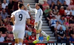 Manchester United's Wayne Rooney celebrates after scoring during the English Premier League soccer match between Bournemouth and Manchester United at Vitality Stadium in Bournemouth, England, Sunday, Aug. 14, 2016. (AP Photo/Frank Augstein)