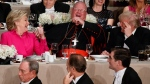 Republican presidential candidate Donald Trump, right, Cardinal Timothy Dolan, Archbishop of New York, centre, and Democratic presidential candidate Hillary Clinton share a laugh during the Alfred E. Smith Memorial Foundation dinner, Thursday, Oct. 20, 2016, in New York. (AP Photo/ Evan Vucci)