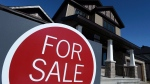 A sign advertises a new home for sale in Carleton Place, Ont., on March 17, 2015. (Sean Kilpatrick/The Canadian Press)
