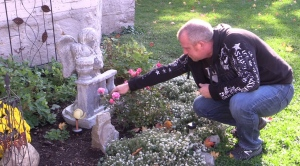 Rodney Stafford tends to a memorial for his daughter Victoria, at his home in Woodstock, Ont. on Sunday, Oct. 23, 2016.