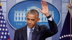 Obama defends Manning decision, gives Trump advice