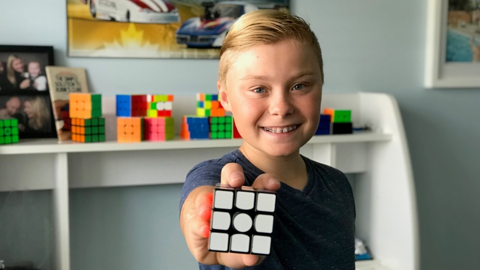 Wyatt Atchison, as seen holding a Rubik Cube
