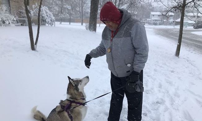 Rashid Skukul, and his husky dog Loki